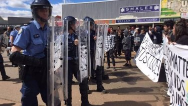 Riot police came face to face with protesters in Kalgoorlie.