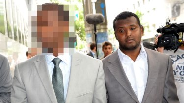 Yacqub Khayre (right) leaving a Melbourne court in 2010.