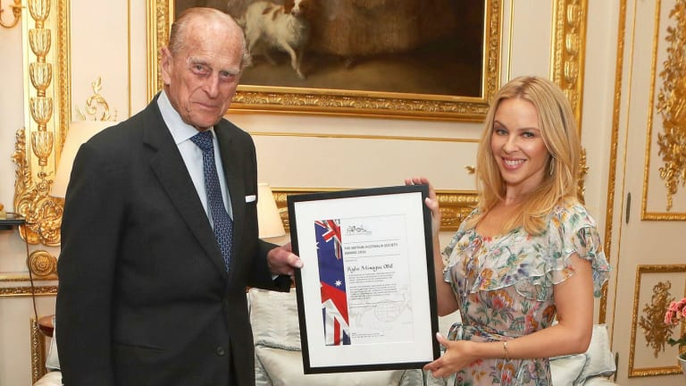 Prince Philip presents Kylie Minogue with the Britain-Australia Society Award.