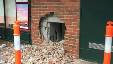 Brazen thieves created left this gaping hole at a newsagency in Warrandyte.