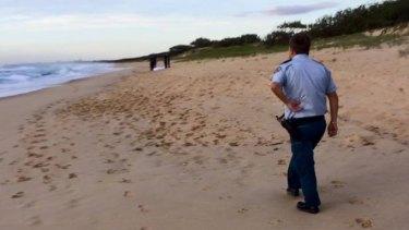 Police at the Warana beach where Steve Halgryn was found.
