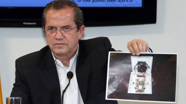 Ecuador's Foreign Minister Ricardo Patino shows a picture of a hidden spy microphone uncovered at the office of Ana Alban, the Ecuadorean ambassador to the United Kingdom.