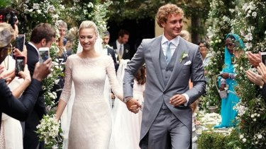 Beatrice Borromeo and Pierre Casiraghi leave their religious ceremony on Saturday.