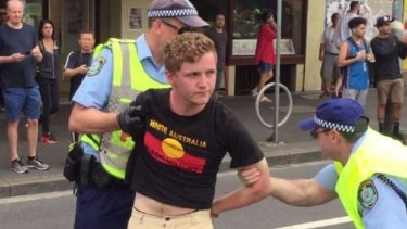 Hayden Williams, 20, was arrested at the protest trying to burn the flag.