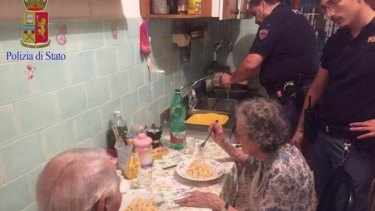 Police prepare pasta for an elderly Roman couple.