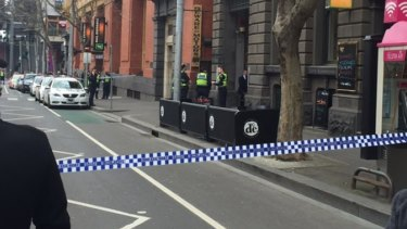 Police at the scene on the corner of Bourke and Spencer streets.