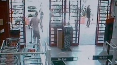CCTV footage from Bunnings that shows a man, whom police allege is Michael Atkins, buying items including a mattock.