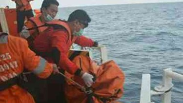 Rescuers assist people injured following an engine explosion aboard a ferry travelling between the Indonesian islands of Bali and Lombok.