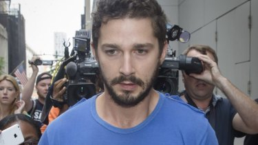 Actor Shia LaBeouf walks through the media after leaving Midtown Community Court on Friday.
