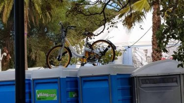 An oBike was left on top of portable toilets in Prahran.