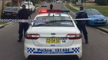 Police taped off Redgum Circuit in Aberglasslyn following the discovery of a girl's body.
