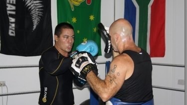Looking sharp...Jesse hits the pads under the watchful eye of his trainer.
