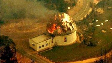 Mount Stromlo Observatory on fire in 2003.