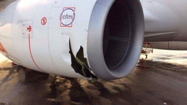 Equipment blown by winds in the storm ruptured the engine of this aircraft at Brisbane Airport.