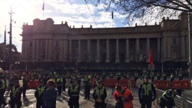 Heavy police presence at Parliament House as rival groups gather to rally.
