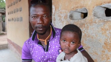 Komba Nyama, pictured with his daughter Betsy, drove Mohamed Mansaray to hospital.
