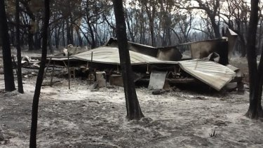 The remains of a fire at One Mile on North Stradbroke Island.
