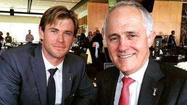Actor Chris Hemsworth and Malcolm Turnbull not watching the AFL grand final, despite having the best seats in the house.