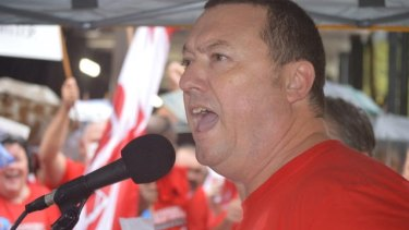 Public Service Association's general secretary, Stewart Little, at a rally urging the government not to cut public disability services.