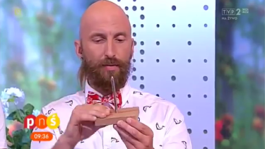 Truly sharp nail ... Magician Marcin Połoniewicz, a semi-finalist on <i>Poland's Got Talent</i>, shows the audience how sharp the nail is before the magic trick.