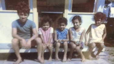 Sam Backo as a nine-year-old, pictured with his four sisters.