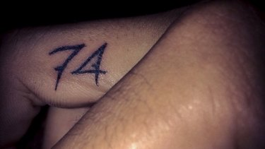 Lest he forgets: Nick Kyrgios' tattoo honours the memory of his grandmother.