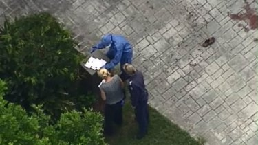 Forensic crews were pictured by helicopter after the horrific attack.