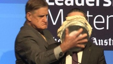 Alan Joyce hit with a pie during an event in Perth.
