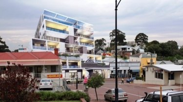 The planned King William Street development will retain the facade of the older building, but the council believes the local DAP applied planning scheme discretions wrongly in approving seven storeys in a 20-metre building, not five as stipulated.