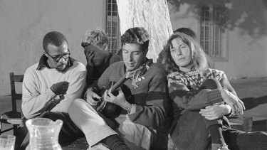 On Hydra: (from left) Charles Heckstall, Klaus Merkel, Leonard Cohen and Charmian Clift at Douskos taverna.