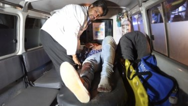 A wounded person is treated in an ambulance after an attack on the American University in the Afghan capital Kabul.