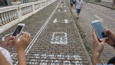 Mobile phone lanes for texters in the Chinese city of Chongqing.