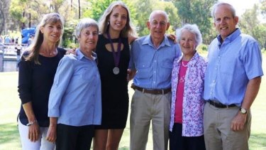 Caitlin with her parents and grandparents after receiving her Beazley Medal.
