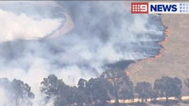 The grassfire is moving in a south-easterly direction.