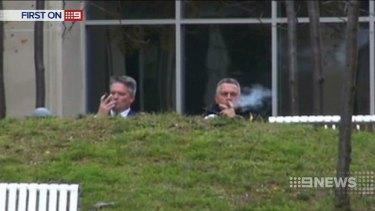 Treasurer Joe Hockey and Finance Minister Mathias Cormann enjoy cigars as the medical community petitions for anti-tobacco funding.