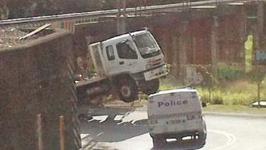A garbage truck snagged by the Blackall Street underpass at Woombye, on the Sunshine Coast line.