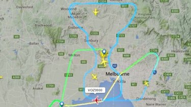"""It took three pilots 32 minutes to """"draw"""" the AFL premiership cup over Melbourne on grand final day."""