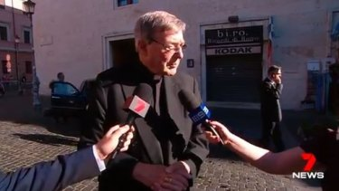 Cardinal George Pell speaking to reporters in Rome on Wednesday.