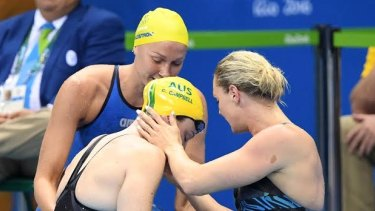 Support: Cate Campbell is comforted by Sweden's Sarah Sjostrom and Denmark's Jeanette Ottesen after her shock 100m loss.