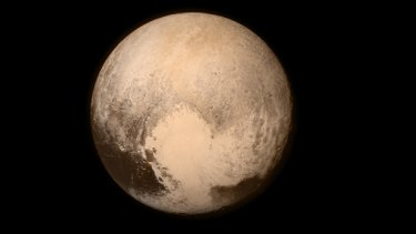 The first close-up picture of Pluto taken by New Horizons, showing the heart-shaped region named the Tombaugh Regio.