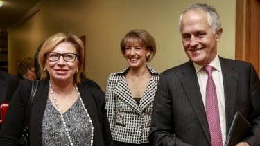 Rosie Batty and Prime Minister Malcolm Turnbull with Minister for Women Michaelia Cash at the announcement of the government's package to tackle domestic violence.