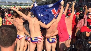 Australians arrested in Malaysia for stripping down at the Grand Prix.