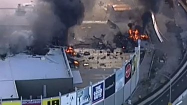 The fiery aftermath of the plane crash at DFO Essendon.