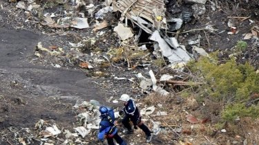 Investigators search through the wreckage of Germanwings Flight 9525 in the French Alps, which crashed at high-speed on Tuesday morning.