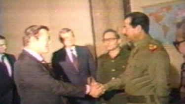 Iraqi President Saddam Hussein greets Donald Rumsfeld, then special envoy of US president Ronald Reagan, in Baghdad on December 20, 1983.