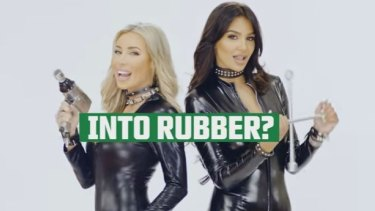 Ultra Tune Australia ad with two women dancing in tight outfits, with the tagline 'we're into rubber'.