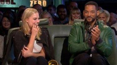 """Margot Robbie watches her lap on """"Top Gear""""."""