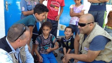 Mohammed al-Halabi meets children displaced during Israel's 2014 Protective Edge offensive in the Gaza Strip.