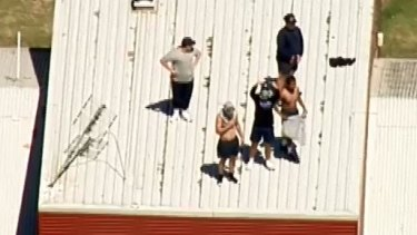 Youths climb onto the roof of the Malmsbury centre during the most recent riot.
