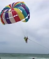 Mr Hussey and a beach crew member in flight before he fell.